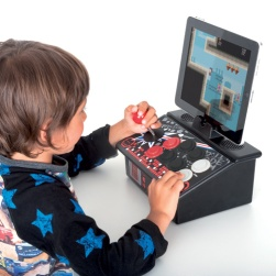 A young boy using a joystick-controlled video game console.